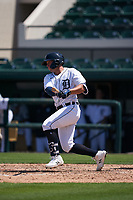 Detroit Tigers Spencer Torkelson (19) bats during a Minor League Spring Training game against the Baltimore Orioles on April 14, 2021 at Joker Marchant Stadium in Lakeland, Florida.  (Mike Janes/Four Seam Images)