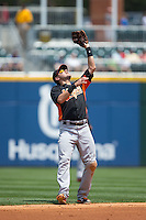 Norfolk Tides shortstop Paul Janish (11) catches a pop fly during the game against the Charlotte Knights at BB&T BallPark on June 7, 2015 in Charlotte, North Carolina.  The Tides defeated the Knights 4-1.  (Brian Westerholt/Four Seam Images)