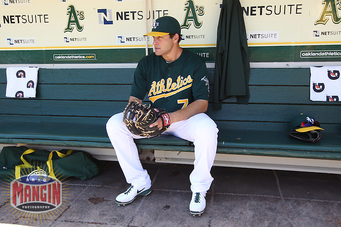 OAKLAND, CA - MAY 1:  Nate Freiman #7 of the Oakland Athletics gets ready in the dugout before the game against the Los Angeles Angels at O.co Coliseum on May 1, 2013 in Oakland, California. Photo by Brad Mangin