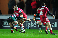 Gareth Davies of Scarlets is tackled by Will Evans of Leicester Tigers during the Heineken Champions Cup round 5 match between the Scarlets and Leicester Tigers at the Parc Y Scarlets Stadium in Llanelli, Wales, UK. Saturday 12th January 2019