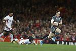 George North bursts through.<br /> <br /> Dove Men Series 2013<br /> Wales v Tonga<br /> Millennium Stadium - Cardiff<br /> 22.11.13<br /> ©Steve Pope-SPORTINGWALES