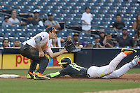 Joe Rizzo (6) of the East team waits for the ball so he can tag Walker Robbins (15) of the West team as he slides into third base during the 2015 Perfect Game All-American Classic at Petco Park on August 16, 2015 in San Diego, California. The East squad defeated the West, 3-1. (Larry Goren/Four Seam Images)