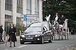 © Joel Goodman - 07973 332324 . 30/06/2017 . Stockport , UK . The funeral procession arrives . The funeral of Martyn Hett at Stockport Town Hall . Martyn Hett was 29 years old when he was one of 22 people killed on 22 May 2017 in a murderous terrorist bombing committed by Salman Abedi, after an Ariana Grande concert at the Manchester Arena . Photo credit : Joel Goodman