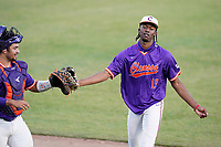 Keyshawn Askew (19) of the Clemson Tigers bumps gloves with catcher Jonathan French in Game 1 of the Orange-Purple intrasquad scrimmage series on Friday, November 20, 2020, at Doug Kingsmore Stadium in Clemson, South Carolina. Orange won, 9-2. (Tom Priddy/Four Seam Images)