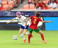 HOUSTON, TX - JUNE 10: Megan Rapinoe #15 of the United States dribbles the ball around Catarina Amado #2 of Portugal during a game between Portugal and USWNT at BBVA Stadium on June 10, 2021 in Houston, Texas.