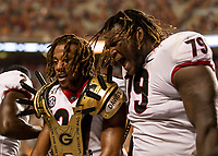 KNOXVILLE, TN - OCTOBER 5: Eric Stokes #27 of the Georgia Bulldogs snd Isaiah Wilson #79 of the Georgia Bulldogs celebrate after Stokes's tackle that caused a fumble during a game between University of Georgia Bulldogs and University of Tennessee Volunteers at Neyland Stadium on October 5, 2019 in Knoxville, Tennessee.