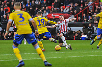 Sheffield United's midfielder John Fleck (4) slides in on Leeds United's midfielder Pablo Hern?ndez (19) during the Sky Bet Championship match between Sheff United and Leeds United at Bramall Lane, Sheffield, England on 1 December 2018. Photo by Stephen Buckley / PRiME Media Images.