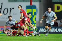 Rob Hawkins of Leicester Tigers (right) keeps an eye on the play as Ruki Tipuna of Scarlets passes from the base of the ruck during the LV= Cup first round match between Scarlets and Leicester Tigers at Parc y Scarlets (Photo by Rob Munro, Fotosports International)