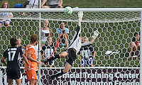 Sky Blue goalkeeper, Jenni Branam, flies to deflect the ball over the crossbar to stop a Freedom attack in the second half.  Sky Blue defeated the Freedom 2-1 in the first WPS playoff game at the Soccerplex in Boyds, Maryland.