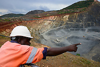 TANZANIA Geita Gold Mine, open-cast gold mine of company AngloGold Ashanti, the ore will be crushed to dust and then treated with high toxic Sodium cyanide to extract maximum amount of gold / TANSANIA Geita Goldmine der Firma AngloGold Ashanti, offener Tagebau, das gefoerderte Erz wird anschliessend zu Staub gemahlen und mit dem hochgiftigen Natriumcyanid wird Gold ausgewaschen