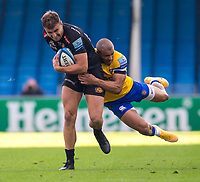 Exeter Chiefs' Ollie Devoto is tackled by Bath Rugby's Jonathan Joseph<br /> <br /> Photographer Bob Bradford/CameraSport<br /> <br /> Gallagher Premiership Semi-Final - Exeter Chiefs v Bath Rugby - Saturday 10th October 2020 - Sandy Park - Exeter<br /> <br /> World Copyright © 2020 CameraSport. All rights reserved. 43 Linden Ave. Countesthorpe. Leicester. England. LE8 5PG - Tel: +44 (0) 116 277 4147 - admin@camerasport.com - www.camerasport.com