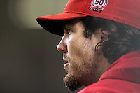Los Angeles Angels pitcher Dan Haren #24 watches a game against the Texas Rangers at Angel Stadium on September 27, 2011 in Anaheim,California. Texas defeated Los Angeles 10-3.(Larry Goren/Four Seam Images)