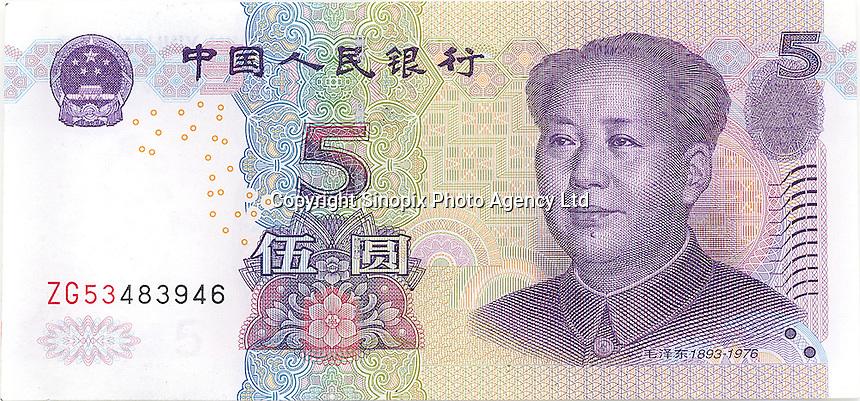 Five RMB banknotes..