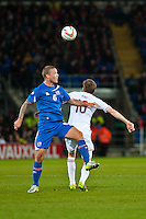 Wednesday 05 March 2014<br /> Pictured:( L-R ) Ragnar Sigurdsson and Andy King battle for the ball <br /> Re: International friendly Wales v Iceland at the Cardiff City Stadium, Cardiff,Wales UK