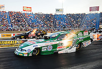 Jul, 8, 2011; Joliet, IL, USA: NHRA funny car driver John Force (near) races alongside Justin Schriefer during qualifying for the Route 66 Nationals at Route 66 Raceway. Mandatory Credit: Mark J. Rebilas-