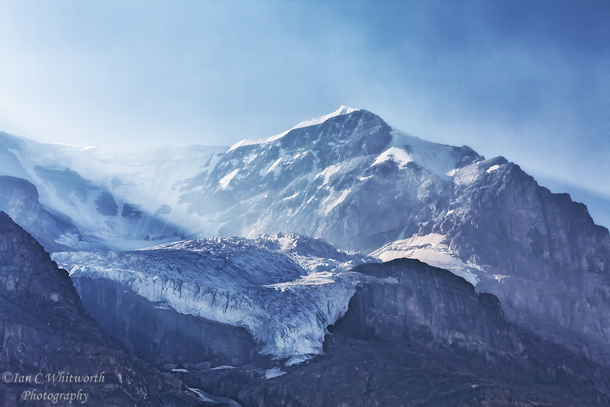 Looking up from Athabasca Glacier at the forest fire smoke in the mountains.