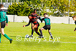Togar Silong of Park FC just gets past Noah Townsend of Fenit Samphires in the U16 Soccer league game