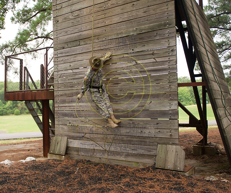 Drill Sergeant Butler demonstrates a head-first rappel off of a 40 foot tower during team camp at Camp Robinson in North Little Rock.<br /> <br /> Special to the Democrat-Gazette/JIMMY JONES