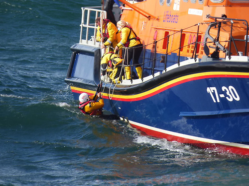 A line was then attached to the lifeboat mechanic who jumped into the water and grabbed the casualty to safety