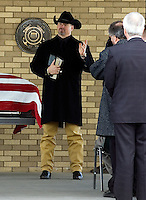 Anchor Way Baptist Church Pastor Dr. Kevin King offers words of love and encouragement to family and friends of Eric O'Hara during a funeral service at Fort Logan National Cemetery in Denver on Thursday afternoon.