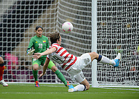 Glasgow, Scotland - Saturday, July 28, 2012: Abby Wambach of the USA Women's soccer team shoots on goal during a 3-0 win over Colombia in the first round of the Olympic football tournament at Hamden Park.