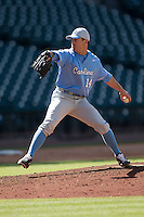 North Carolina Tar Heels relief pitcher Chris O'Brien #14 delivers a pitch to the plate against the California Golden Bears in the NCAA baseball game on March 2nd, 2013 at Minute Maid Park in Houston, Texas. North Carolina defeated Cal 11-5. (Andrew Woolley/Four Seam Images).