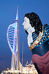 United Kingdom, England, Hampshire, Portsmouth: Gunwharf Quays, night shot of ships figurehead in front of Spinnaker Tower