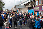 Burnley 1 West Ham United 3, 18/10/2014. Turf Moor, Premier League. Spectators arriving along Harry Potts Way outside The fixture was won by the visitors by three goals to one watched by 18,936 spectators. The defeat meant that Burnley still had not won a league match since being promoted from the Championship the previous season. Photo by Colin McPherson.
