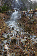 A seasonal waterfall on the western flank of Mount Lafayette in Franconia Notch, New Hampshire during a rainy spring day. Most of the seasonal waterfalls on the western flank of Mount Lafayette are high on the mountainside and are difficult to reach.