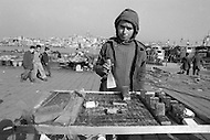 Child employed to sell traditional pastry in the street in Istanbul, Turkey - Child labor as seen around the world between 1979 and 1980 – Photographer Jean Pierre Laffont, touched by the suffering of child workers, chronicled their plight in 12 countries over the course of one year.  Laffont was awarded The World Press Award and Madeline Ross Award among many others for his work.
