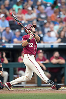 Florida State Seminoles third baseman Drew Mendoza (22) follows through on his swing during Game 9 of the NCAA College World Series against the Texas Tech Red Raiders on June 19, 2019 at TD Ameritrade Park in Omaha, Nebraska. Texas Tech defeated Florida State State 4-1. (Andrew Woolley/Four Seam Images)