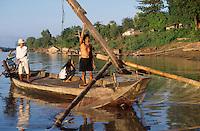 CAMBODIA Mekong river near Kratie, fishing boat / KAMBODSCHA Mekong Fluss bei Kratie, Fischer mit Boot