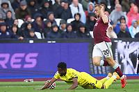 3rd October 2021;   City of London Stadium, London, England; EPL Premier League football, West Ham versus Brentford; Jarrod Bowen of West Ham United fouls Frank Onyeka of Brentford