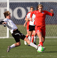 Allie Long of the Washington Freedom has the ball tackled away from her by Joanna Lohman of the Philadelphia Independence during their preseason game at the Maryland SoccerPlex in Germantown, Maryland.