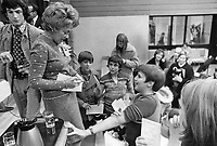 1972 FILE PHOTO - ARCHIVES -<br /> <br /> Francoise Laporte, widow of the Quebec labor minister who was kidnapped and murdered two years ago, signs autographs after officially opening Pierre Laporte Junior High School in Downsview last night. Mrs. Laporte, a citizenship court judge in Montreal, was cheered frequently during the 90-minute ceremony.<br /> <br /> PHOTO : Ron BULL - Toronto Star Archives - AQP