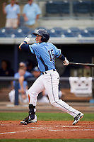Charlotte Stone Crabs left fielder David Olmedo-Barrera (15) follows through on a swing during a game against the Palm Beach Cardinals on April 12, 2017 at Charlotte Sports Park in Port Charlotte, Florida.  Palm Beach defeated Charlotte 8-7.  (Mike Janes/Four Seam Images)