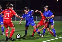 Emily Steijvers of Racing Genk pictured in a fight for the ball with Woluwe's Sheila Broos (20) and Luna Vanhoudt of Racing Genk during a female soccer game between  Racing Genk Ladies and White Star Woluwe on the seventh matchday of the 2020 - 2021 season of Belgian Scooore Womens Super League , friday 13 th of November 2020  in Genk , Belgium . PHOTO SPORTPIX.BE | SPP | DAVID CATRY