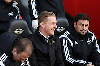 Pictured L-R: Kristian O'Leary, Swansea manager Garry Monk and Josep (Pep) Clotet Sunday 01 February 2015<br />