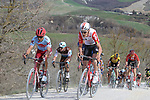 The peloton including Tiesj Benoot (BEL) Lotto-Soudal and Ruben Guerreiro (POR) Team Katusha Alpecin give chase on sector 8 Monte Santa Maria during Strade Bianche 2019 running 184km from Siena to Siena, held over the white gravel roads of Tuscany, Italy. 9th March 2019.<br /> Picture: Seamus Yore   Cyclefile<br /> <br /> <br /> All photos usage must carry mandatory copyright credit (© Cyclefile   Seamus Yore)