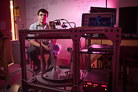 Electrical Engineering and Mathematics Major Henrique Miller demonstrates a Planeterella Device, an aurora borealis simulator that functions on glow discharge DC plasma, which he helped construct in the physics lab inside UAA's Natural Sciences Building.