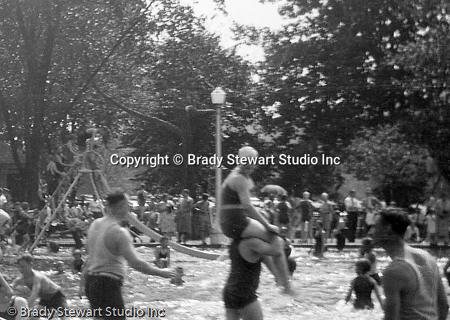 "South Park PA: View of the second slide and people having fun at the South Park Swimming pool. The philosophy of recreation in the '20s and '30s was different than it is today. The differences between the haves and the have-nots of society were understood differently, and the county parks were called ""the people's country clubs,"" bringing to poorer people the same recreation that the wealthy paid for at private clubs: golf, tennis, swimming, picnicking. The parks offered common folk the chance to escape to rural campgrounds, day camps, and ""retreats."" Certain modern recreational concepts had not yet arrived: people didn't ""swim,"" they ""bathed""; hence, a large South Park pool was only four feet deep at its deepest point."