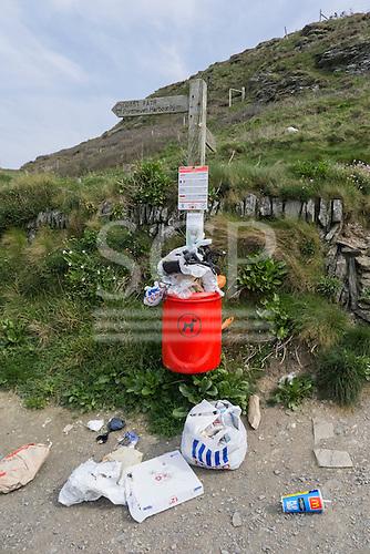 Coastal path, Cornwall. Rubbish overflowing bin.