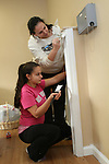WATERBURY, CT31 December 2013-123113LW01 - Anele Barbieri, top, and her 14-year-old daughter, Gina Barbieri, apply a fresh coat of paint to the lobby at Art in Motion dance studio in Watertown Tuesday.<br /> Laraine Weschler Republican-American