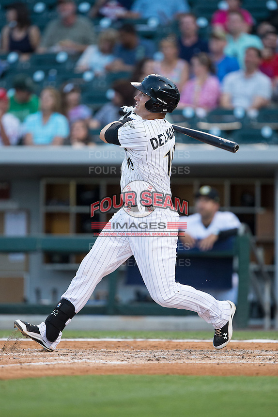 Nicky Delmonico (10) of the Charlotte Knights follows through on his swing against the Syracuse Chiefs at BB&T BallPark on June 1, 2016 in Charlotte, North Carolina.  The Knights defeated the Chiefs 5-3.  (Brian Westerholt/Four Seam Images)