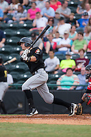 Kevin Newman (5) of the West Virginia Power follows through on his swing against the Hickory Crawdads at L.P. Frans Stadium on August 15, 2015 in Hickory, North Carolina.  The Power defeated the Crawdads 9-0.  (Brian Westerholt/Four Seam Images)
