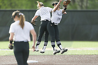 Bentonville shortstop Kenzie Derryberry (22) and second baseman Emily Perry (20) performa ritual, Thursday, April 29, 2021 during a softball game at Bentonville High School in Bentonville. Check out nwaonline.com/210430Daily/ for today's photo gallery. <br /> (NWA Democrat-Gazette/Charlie Kaijo)