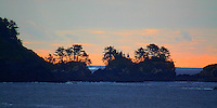 THE SETTING SUN PROVIDES A SILHOUETTE FOR THE ISLANDS OF BARKLEY SOUND ON BRITISH COLUMBIA'S VANCOUVER ISLAND,CANADA