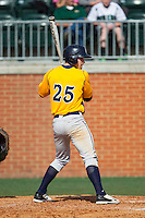 Jesse Puscheck (25) of the Canisius Golden Griffins at bat against the Charlotte 49ers at Hayes Stadium on February 23, 2014 in Charlotte, North Carolina.  The Golden Griffins defeated the 49ers 10-1.  (Brian Westerholt/Four Seam Images)