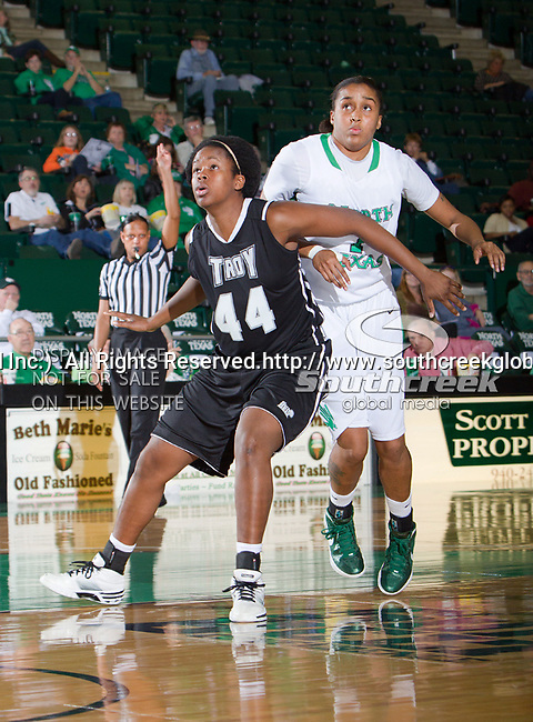 North Texas Mean Green forward Ash'Lynne Evans (1) and Troy Trojans forward Tenia Manuel (44) in action during the game between the Troy Trojans and the University of North Texas Mean Green at the North Texas Coliseum,the Super Pit, in Denton, Texas. UNT defeats Troy 57 to 36.....