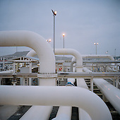 Sangachal, Azerbaijan .December 11, 2006..Sangachal British Petroleum gas and oil terminal that feeds from their off-shore rigs to the newly constructed pipeline to the Baku-Tbilisi-Ceyhan pipeline (BTC)...This is the actual pipeline that cares the gas and oil to Turkey and markets around the world by-passing Russia for the first time. It enters the ground here and comes up 1,776km to the west in Ceyhan, Turkey...The 4 billion dollar pipeline is the world's second longest pipeline. It will care 1 million barrels of oil a day when fully operational.....